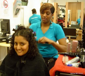 Nita has her hair straightened and styled by one of the Hair Team