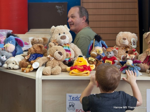 A young boy sneaks a peek at the numerous cuddly toys on offer in the raffle