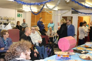 Members and staff gather to enjoy food, drink and conversation