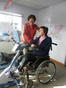 An MS patient using an exercise bike from her wheelchair