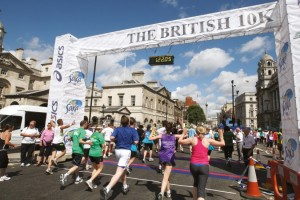 Runners crossing the finish line of the British 10k London Run