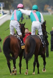 Two jockeys arm-in-arm