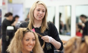 A smiling customer getting her hair styled at Image Salon