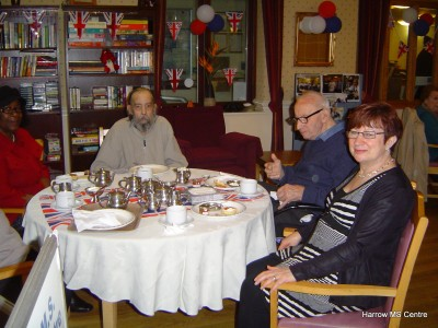 People enjoying cream teas inside Brook House Care Centre