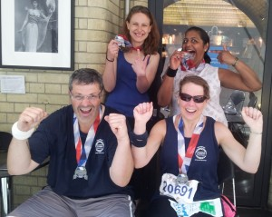 Back row: Anna West and Nishma Shah; front row: Paul and Carol Sutton, all proudly displaying their British 10K run medals