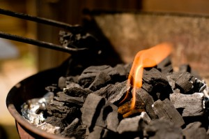 Barbecue charcoal with an orange flame