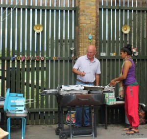 Mick and Apeksha cooking on the grill.