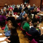 A crowded hall full of Autumn Quiz Supper teams