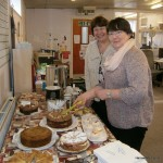 Miriam and Ann put out the cakes Ann has made.