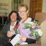 Centre manager Lynn Hurst presents Jane with flowers as a token of the Centre's appreciation for her efforts