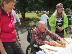 At the Eastcote Garden Picnic a punter tries his hand at the Roll-a-10penny.