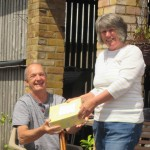 Linda receives a presentation from chair Jerry, in recgonition of her 25 years at the Centre