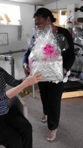 Paulette hands raffle prize to lucky winner Sharon.