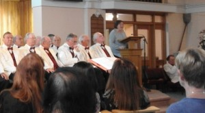 Lynn addresses audience at Harrow Apollo Male Choir concert