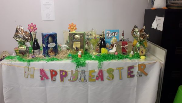 A table of Easter goodies with a Happy Easter banner below
